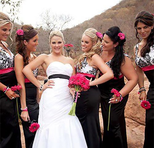 One Bride in white surrounded by five bridesmaids in black on wedding day